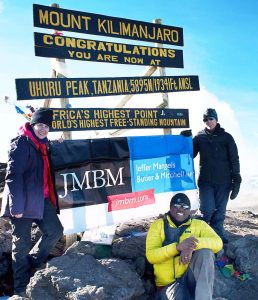 Capoccia, Oketch and Bonstelle at the peak of Kilimanjaro.